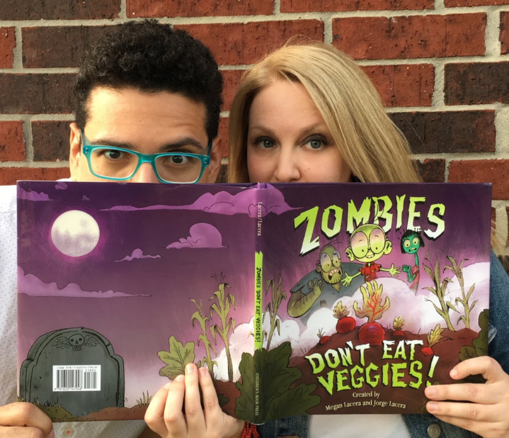 Jorge and Megan Lacera with a copy of Zombies Don't Eat Veggies